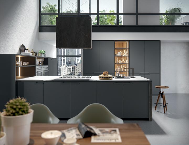 Cuisine contemporaine de marque Valdesign en laqueé mat gris foncé et plan de travail en inox massif