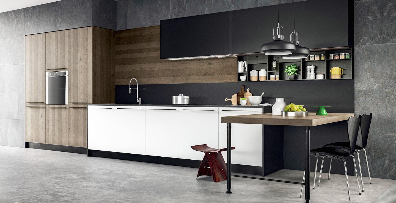 Cuisine contemporaine de marque Armony en plaqué massif et fenix blanc et plan de travail en Dekton